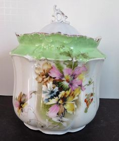 This nice, old biscuit barrel came from an area estate. It stand about 7 tall with the lid.) decorate the front and back; there is a large fern green upper b Antique Dishes, Vintage Dishes, Vintage Tea, Vintage Ceramic, Antique China, Biscuits, Multi Colored Flowers, Pickle Jars, Tea Pot Set