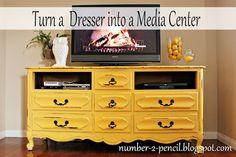 Vintage dresser turned media center. Think I may have to go on a treasure hunt. :)