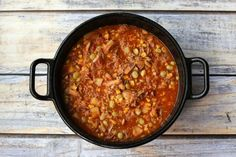 This easy Brunswick stew recipe is made with a combination of pulled or shredded pork and shredded chicken thighs, and it's ready in an hour. It's a budget-friendly classic, perfect for an everyday fa(Classic Chicken Stew) Best Chicken Thigh Recipe, Chicken Pork Recipe, Chicken Thigh Recipes, Southern Brunswick Stew Recipe, Traditional Brunswick Stew Recipe, Homemade Brunswick Stew Recipe, One Pot Meals, Main Meals, Soups And Stews