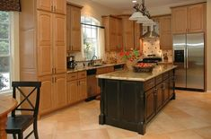 """New black kitchen island - See the """"before"""" oddly shaped island."""