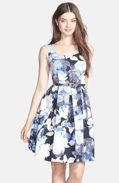 Free shipping and returns on Eliza J Scoop Neck Floral Print Fit & Flare Dress at Nordstrom.com. A blue-hued floral print wafts garden-party charm across a faille-woven dress designed with a scoop-neck bodice to highlight the décolleté, a shimmering, slender belt to define the silhouette and a pleat-flared skirt for a flirty finish.