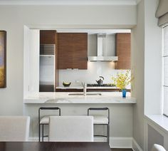 An large opening with pocket doors was created between the dining room and kitchen.