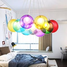 Quiet neutral color schemes may be in style, but that doesn't mean that you still can't have fun with color. Let the more sublet elements of your decor be a frame for one bright feature. Add a pop of color to an otherwise simple room with this fun chandelier. Get more lighting inspiration at www.nightignites.com!