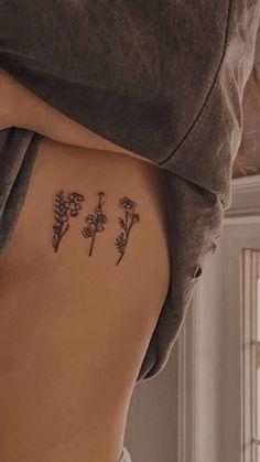 Small Rib Tattoos, Flower Tattoo On Ribs, Rib Tattoos For Women, Hip Tattoo Small, Elbow Tattoos, Small Pretty Tattoos, Tattoos Of Flowers, Above Elbow Tattoo, Around Arm Tattoo