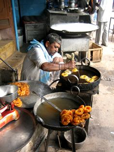 A street vendor fries jalebi sweets in Chandni Chowk, Old Delhi, India (2006)