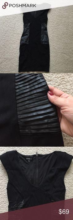 Bebe waist accentuated black sexy stretchy dress Bebe waist accentuated shoulder pads and zipper closer dress. Size xs, like new bebe Dresses Mini