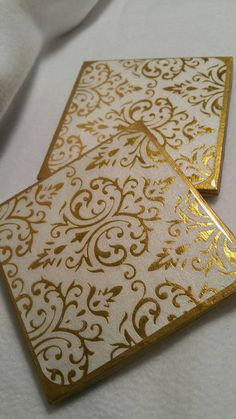 Check out this item in my Etsy shop https://www.etsy.com/listing/277530690/white-and-gold-damask-coaster-set