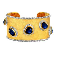 Victor Velyan gold bracelet with 15.43ct blue sapphires and diamonds. Via thejewelryeditor.com
