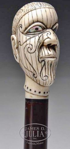 Moby Dick Queequeg Cane; Ivory Handle, , Exotic Wood Shaft, 36 inch.  A scrimshaw Queequeg head cane. Walking stick having a heavily scrimshawed carved ivory handle in the form of the mythological Queequeg character