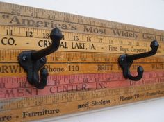 Vintage Yardstick Coat Rack - 30 inches. This clever coat or hat rack is made from vintage yardsticks collected from across the country. It is trimmed to be 30 inches long and has four 2-prong iron hooks to hang coats, bags, hats, towels, decorations, or anything else youd like. This is a cute little item that would compliment any room or porch with a hand-made or country feel. vintage