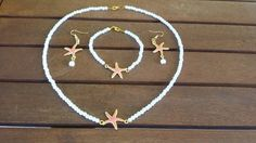Romantic coral starfish neckless set with bracelet and earring dacorated with white acrylic pearls  This jewelery set includes: 1 coral starfish neckless