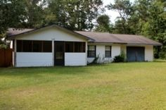 173 Wiley Smith Road, Lucedale Great Investment Opportunity!  A fixer upper on over 6 acres! Very private setting with a greenhouse and shed.  Also a fenced back yard.