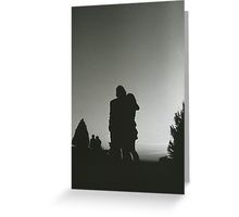 Wedding guests walking holding in silhouette at sunset in marriage party silver gelatin black and white 35mm negative analog film photo  Greeting Card