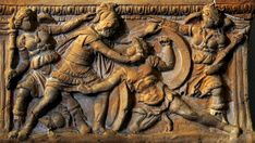 Mortal duel between Eteocles and Polynices. Relief of the front of etruscan cinerary urn. Terracotta. 2nd century B.C. Verona, Museum-Lapidarium of Maffei.