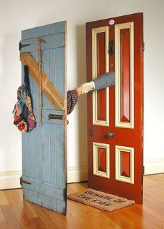 Next-Door Neighbours, 2000 carved salvaged Huon pine, cedar door, hardwood door, sleeves, walking stick, bag, bullet casings 202 x 103 x 98 cm by © Susan Dorothea White