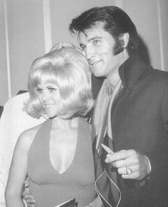 {*Elvis with a lucky lady *}