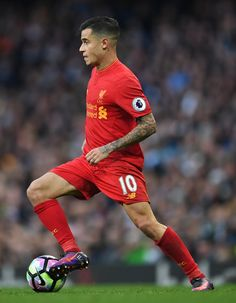 Philippe Coutinho of Liverpool in action during the Premier League match between Manchester City and Liverpool at Etihad Stadium on March 19, 2017 in Manchester, England.