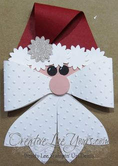 I just can't get enough the Gift Bow Bigz die. Here was an adorable Santa I found a similar version of on pinterest and had to try. I started by cutting out the long loop and two tails in whisper white cardstock using the gift bow die. I used the polka dot embossing folder to …