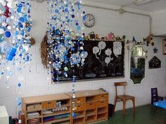 Clouds & Rain chandelier made from recycled bottle caps and fishing line