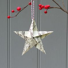 Paper Christmas Ornaments Ideas - It is easy to get started with these lovely paper craft ornaments using a simple origami fold and a dab of glue.