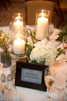 1) Cheap  2) Candles are never too old or new  3) We can use the short/simple bouquets from the church isles  4) Lots of details make it not too simple.  And it's still simple enough.
