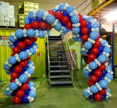 Balloon arch, made of several intertwined link-o-loon garlands.