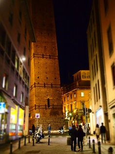 """""""One of the Two Towers, both of them leaning, in the heart of Bologna. Named after their the families who funded them (Asinelli and Garisenda) they dominate the views of the city. Especially lit up at night. They were built some time around 1000-1200AD"""" - """"Bologna in a Blur"""" by @legalnomads"""