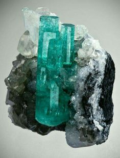 Emerald with Calcite from Coscuez Mine, Boyaca Dept., Colombia Credit: The Arkenstone Amazing Geologist