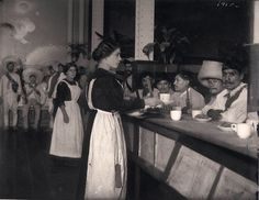 Peasant Zapatistas, members of a Mexican insurgent group, are fed breakfast at the famous restaurant Sanborns, Agustin Casasola, Mexico City, 1914