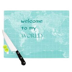 """KESS InHouse Welcome to my World Quote by Catherine Holcombe Cutting Board Size: 0.5"""" H x 11"""" W x 7.5"""" D, Color: Aqua"""