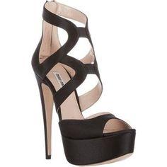 Sofia Vergara wearing Miu Miu Satin Platform Sandals
