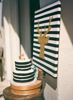SIGN! JST USE BLACK TAPE AGAINST WHITE BOARD TO CREATE STRIPES | Green, gold, & black modern-rustic baby shower  {The Frosted Petticoat}
