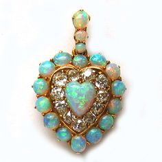 A VICTORIAN OPAL AND DIAMOND HEART PENDANT Circa 1860