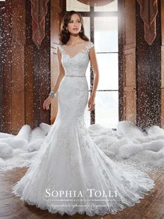 SOPHIA TOLLI | Cap sleeve lace wedding dress, trumpet gown with sweetheart bodice highlighted by a sheer bateau neck, bodice with lace appliqués, crystal hand-beaded belt at natural waist, back zipper is trimmed with diamante buttons and a lace trimmed chapel length train.