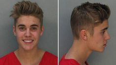 Justin Bieber Mug Shot released after he was arrested. Who smiles in there mug shot?