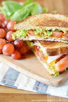 Avocado Turkey Sandwich2 slices whole wheat bread 1-2 slices oven roasted turkey 1 slice Sargento Cheddar Cheese 1 slice of bacon, cooked and cut in half 1/4 avocado tomato slices small pinch of salt and pepper