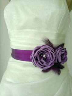 Handcraft Lavander and Purple Two Flowers With Feathers Wedding Bridal Sash Belt. $39.50, via Etsy.