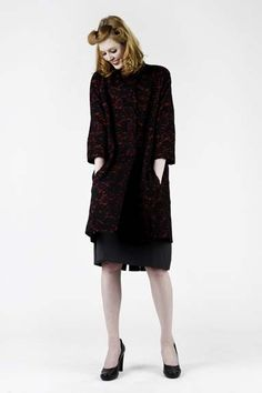 Lace over red wool coat made by Melisa Hart owner at Stitchology fabric store.