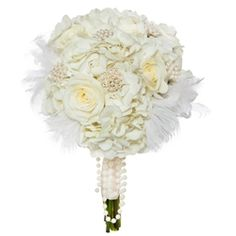 Annata: a vintage style white rose and hydrangea bouquet.    #Whitehydrangeas #Whiteroses #feathers #pearlclusters #Bouquet #Whitebouquet #Weddings