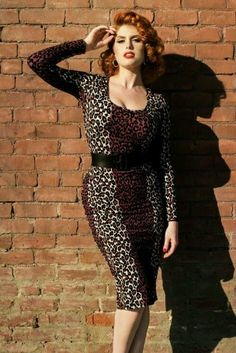 Deadly Dames Hotrod Hiney wiggle dress in 1950s leopard print by Pinup Gurl Clothing, L.    Rev up your engines ladies, there are dangerous curves ahead! This supremely comfortable, easy to wear knit fabric loves your shape and is not afraid to show it. As comfortable as a soft t-shirt. And your hips? Only a potted plant could fail to be entranced by your killer curves. Youll feel like a ferocious Deadly Dame in this sexy leopard print dress.    Large. Laying flat and unstretched the bust…