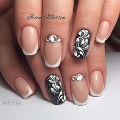 French manicure with black and white patterns decorated with rhinestones.    OCTOBER 1, 2017BLACK, RHINESTONES, SHORT, SQUOVAL, WHITE