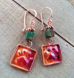 Hey, I found this really awesome Etsy listing at https://www.etsy.com/listing/99918414/square-copper-paw-print-earrings