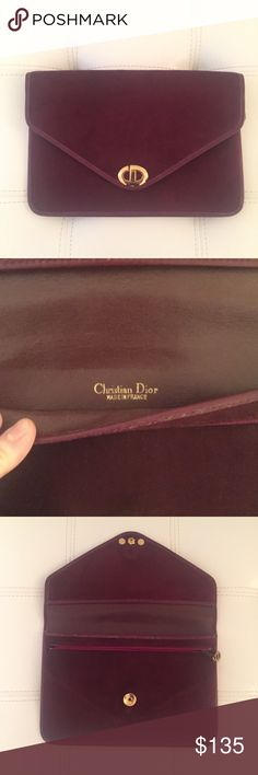 Christian Dior clutch Vintage Christian Dior clutch with gold CD clasp and interior zipper. In a gorgeous shade of oxblood/maroon in good condition. 10 inches wide by 7 inches tall. Christian Dior Bags Clutches & Wristlets