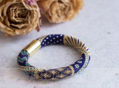 This luxurious crochet bracelet is made of high quality Japanese seed beads TOHO /15. I used rich colors: Antique Bronze, Transparent Frosted Cobalt, Galvanized Starlight and Matte Galvanized Starlight (colors beads in a permanent finish)  Decorated with magnetic clasp.  Thickness - 1 cm/0.4, lenght 20 cm/7,8 Best fit on wrist 6 (15-17 cm) wide.  This braclelet could be made to order for your size of the wrist (wait 2-3 weeks). If you need another size of this bracelet - contact me.  All my…