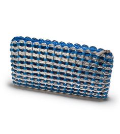 "Can Tab Credit Card Case--$24.00     Soda tabs credit card case will hold the bare essentials: credit cards, lip gloss and cash. ◦It has a zipper closure  matching color fabric liner. ◦Size 5"" L x 3"" H x 1""D ◦Thread color options: Silver, Black, Red, Lime Green, Jeans Blue, Orange, Pink"