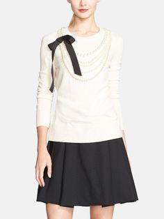 Such a sweet Kate Spade sweater. The pearl and bow embellishments add a touch of elegance.