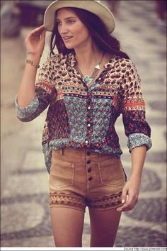 High waisted shorts can look fab with a cowboy hat. A dash of junk jewelry can do wonders to the entire look.