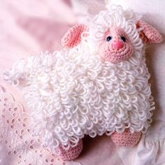 "Little Lamb Pillow Crochet ePattern - Number of Designs: 1Approximate Design Size: 10"" tall x 9 3/4"" long, including tailDesigner: Sue PenrodOriginal Publication: Leisure Arts The Magazine, April 1992 issue †Description: What child could resist this little lamb as a bedtime companion? The snow-white fleece and gentle expression of this crocheted pillow will ensure nights filled with sweet dreams! Featuring the Loop Stitch, our lamb is crocheted using worsted weight yarn and a size F (3.75…"
