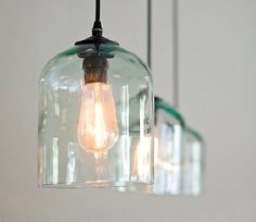 """""""The Jug Light exemplifies a cost-effective solution to an otherwise overpriced retail fixture. Desiring a modern and simple aesthetic, the Jug Light was fabricated from a reclaimed and modified half-gallon sflint glass laboratory jug paired with a custom-designed steel assembly."""""""