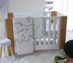 This modern black & range features cute polar bears and a dramatic swiss cross print. Black, white and grey are perfect for any nursery design.